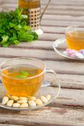 traditional tunisian green tea with peppermint and nuts - stock photo