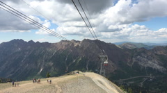 Aerial tram arriving at top of mountain HD 360 Stock Footage
