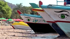 Western Asia Red Sea Jordan Aqaba 030 boats bows in a row on beach Stock Footage