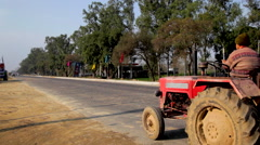 Tractor Driving on Road Stock Footage