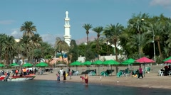 Western Asia Red Sea Jordan Aqaba 033 beach scene with palm trees and mosque Stock Footage