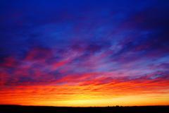 Beautiful sunset over fields Stock Photos