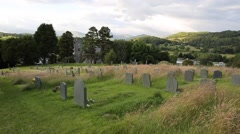 Stock Video Footage of Hawkshead churchyard and graveyard Lake District Cumbria England UK