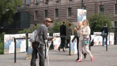 Homeless man near National election posters in sweden 2014 Stock Footage