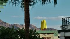 Western Asia Red Sea Jordan Aqaba 044 yellow logo of fast food restaurant Stock Footage