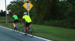 Bicycling, Cyclists Riding Together on Back Roads in Slow Motion - stock footage