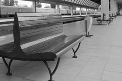 Empty benches at railway station Stock Photos