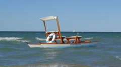 Traditional pedalo, rimini, italy, slow motion Stock Footage