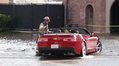 Firefighters Turn Vehicles Back From Flood Stock Footage