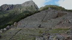 Tourists visiting Machu Picchu, Peru - UNESCO World Heritage Site Stock Footage