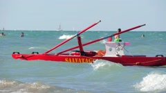 Typical red rescue boat and swimmers, Rimini, Italy Stock Footage