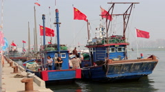 Fishing boat back to port Stock Footage