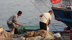 Fishermen back to fishing port with fresh sea products Stock Footage