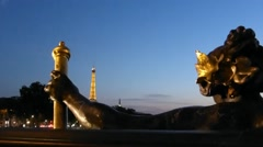 Eiffel Tower night view seeing thru sculpture on Paris Pont Alexander III bridge Stock Footage