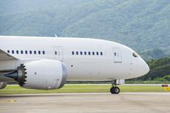 Commercial airplane taxiing to runway - stock photo