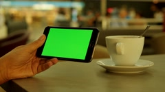 Tablet phone with green screen - isolated display - cafe cafeteria - networking Stock Footage