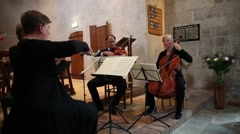 Quartet of musicians playing Stock Footage