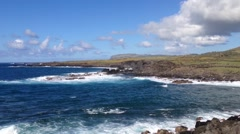 Pan from the sea to fallen moai at the Easter Island, Rapa Nui Stock Footage