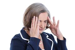 stressed and isolated older woman having headache or problems. - stock photo