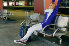 Happy girl stretching and relaxing on the station Stock Footage