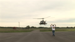 UH-1 Iroquois gunship lands at airport Stock Footage