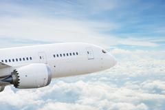 Airplane over clouds Stock Photos