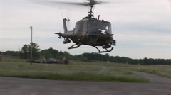 Helicopter gunship lands at airbase Stock Footage
