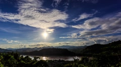 HD Time lapse. Sunset, moving clouds over the river - stock footage