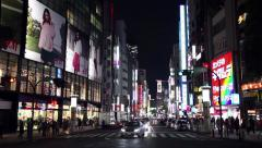 People traffic buildings neon lights Shibuya Tokyo Japan Asia Stock Footage
