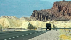 Death Valley, truck in shimmering heat Stock Footage