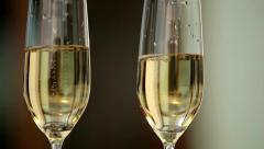 Waiter holding a tray of two glasses with champagne shows visitors. Close up. Stock Footage