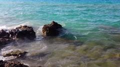 Waves splashing rocks  Stock Footage