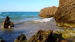 Waves splashing rocks - Mysterious beach Stock Footage