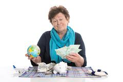 Isolated happy senior woman or pensioner - money concept for traveling. Stock Photos