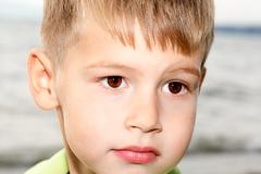 the boy with beautiful eyes on the seacoast - stock photo