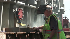 Industrial Welders Secure and Electrical Transformer to a Rail Car - 01 Stock Footage