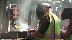 Industrial Welders Secure and Electrical Transformer to a Rail Car - 03 Stock Footage