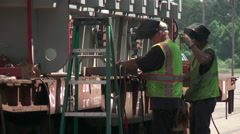 Industrial Welders Secure and Electrical Transformer to a Rail Car - 05 Stock Footage