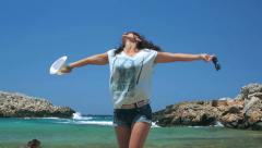 Happy woman standing on the beach and feeling free Stock Footage