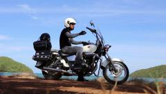 Road Warrior Motorcycle Biker Takes A Break Stock Footage