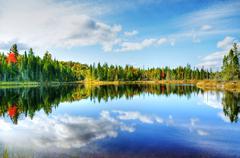 hdr rendering fall season at a northern lake - stock photo