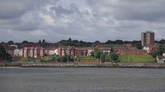 Tracking shot of wirral peninsular coastline along river mersey, england Stock Footage