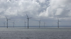 zoom out, wind farm in irish sea in liverpool bay, england, uk - stock footage