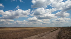 Field road through arable land - stock footage