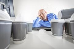 Overworked and bored businessman at office Stock Photos