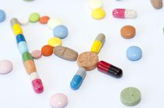 Prescription symbol Rx made of drugs Stock Photos