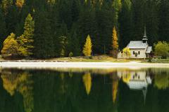 church reflection on lago di braies, dolomites, italy - stock photo
