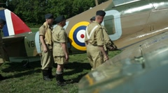 World War II Reenactors - British Aircrew with Spitfire Fighter Plane Stock Footage