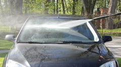 Close wash car windscreen with strong pressure water equipment Stock Footage