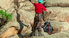 Climber preparing to ascend the rock Stock Footage